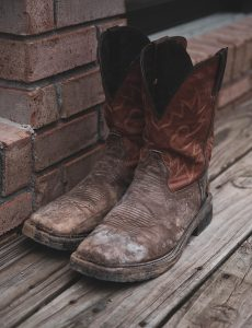 cowboy boots sitting on porch
